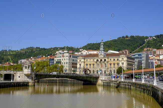 Spain- Biscay- Bilbao- Clear blue sky over arch bridge across Nervion river canal