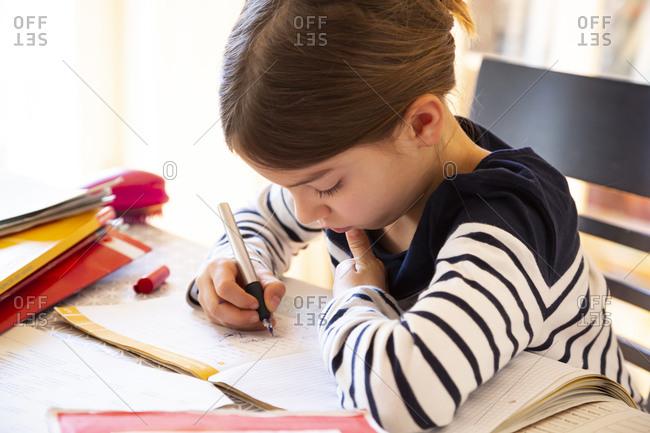 Girl doing homework at home