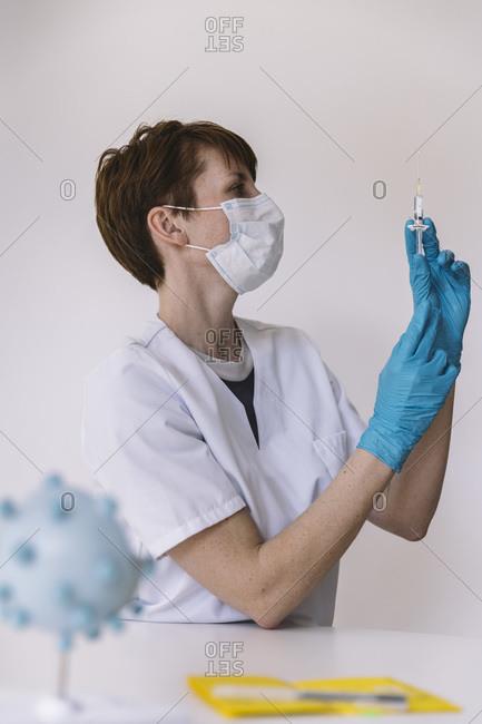 Doctor preparing injection with Corona virus vaccine