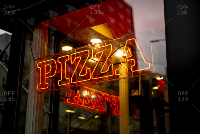 Pizza sign in New York City, USA