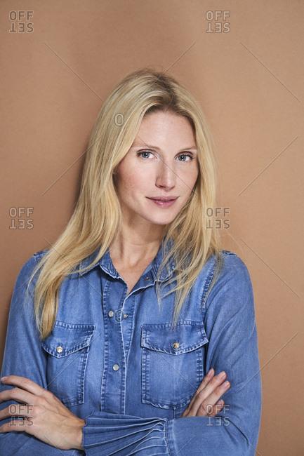 Portrait of beautiful woman wearing denim shirt