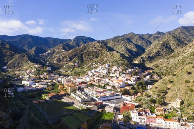 Spain- Province of Santa Cruz de Tenerife- Vallehermoso- Aerial view of town located in hilly valley of La Gomera island