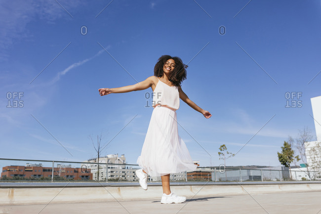 Portrait of happy young woman dancing