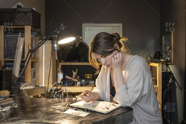 Jewelry designer working on design plans