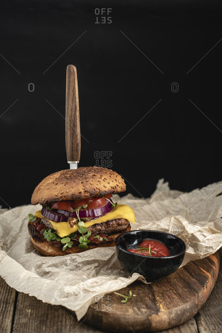 Studio shot of ready-to-eat hamburger with red bell pepper- onions and cheese