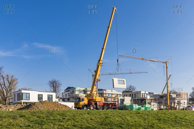 Germany- Baden-Wurttemberg- Ludwigsburg- Mobile crane at construction site in modern suburb