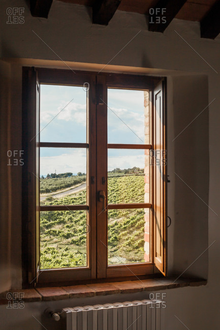 View of landscape through the window in Trequanda, Tuscany, Italy