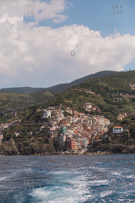 View of Riomaggiore, Cinque Terre, Italy from the back of a boat