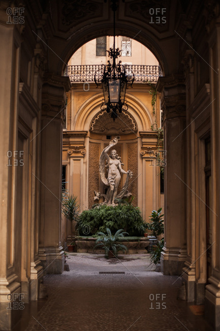 Rome, Italy - June 21, 2018: Interior view of sculpture at the end of a hallway in Trastevere