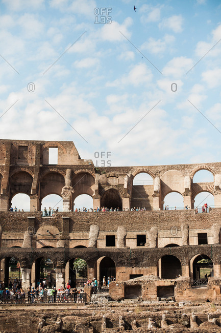 Rome, Italy - June 21, 2018: Crowds touring the Colosseum on a beautiful day