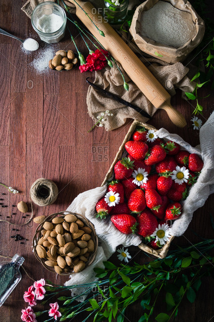 Ingredients for making mini strawberry galettes with almonds, vanilla bean and black peppercorns