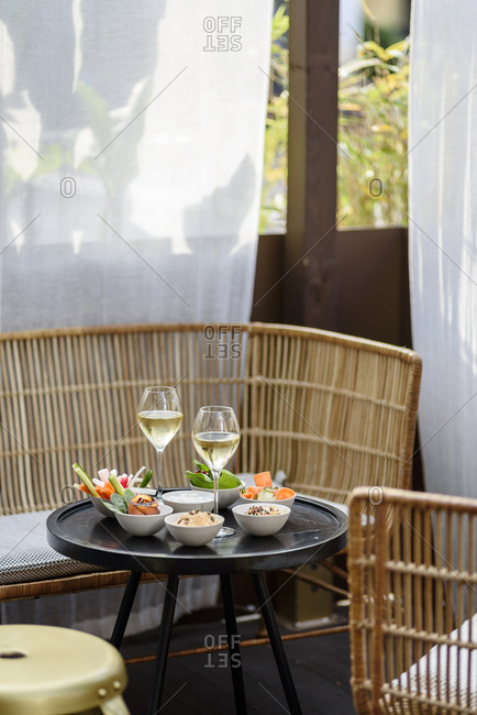 Aperitif with vegetables and white wine on a bar terrace in Nice, France