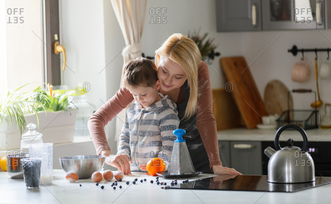Mom and son have fun cooking in the kitchen