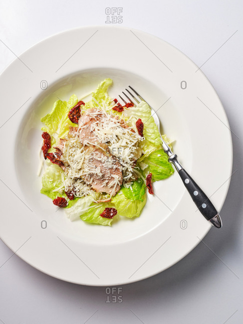 Salad with meat and dried red peppers