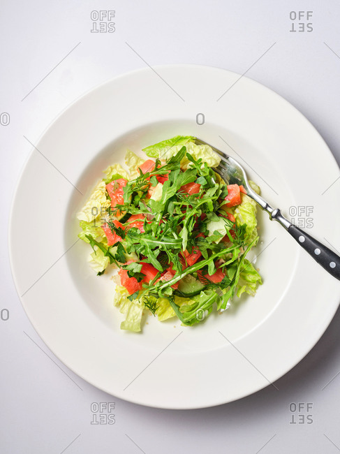 Simple side salad with cucumber and tomato