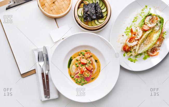 Nori wraps with tuna and shrimps, Romano salad with Grana Padano cheese, royal prawns, cherry tomatoes and breadcrumbs, and Tuna A la Nicoise salad.