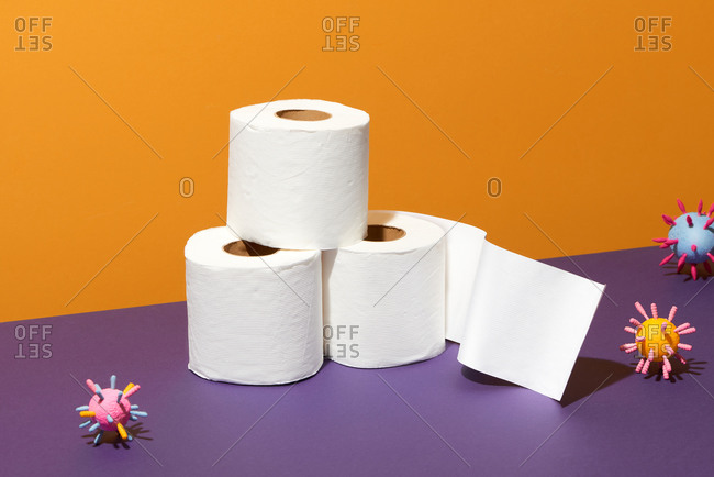 Toilet paper rolls stacked with virus covid-19 virus molecules
