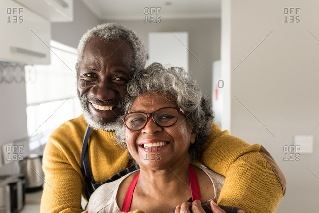 A senior African American couple spending time at home together, social distancing and self isolation in quarantine lockdown during coronavirus covid 19 epidemic