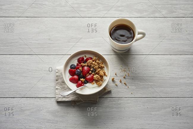 Breakfast berries with coffee and orange juice