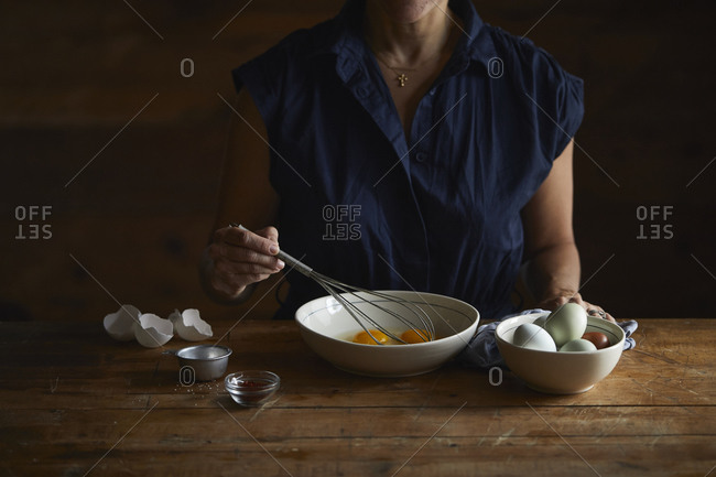 Woman beating eggs with whisk
