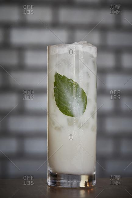 Cocktail with basil leaf inside