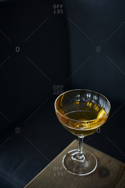Golden Cocktail on corner of table at bar