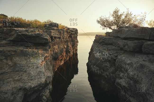 Rocky edges of a cliff at sunset