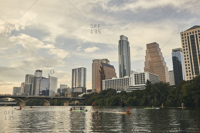 Austin, Texas - September 1, 2019: Standup paddleboarding with Austin skyline in the background