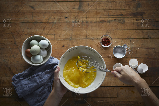 Beating eggs with whisk and spices