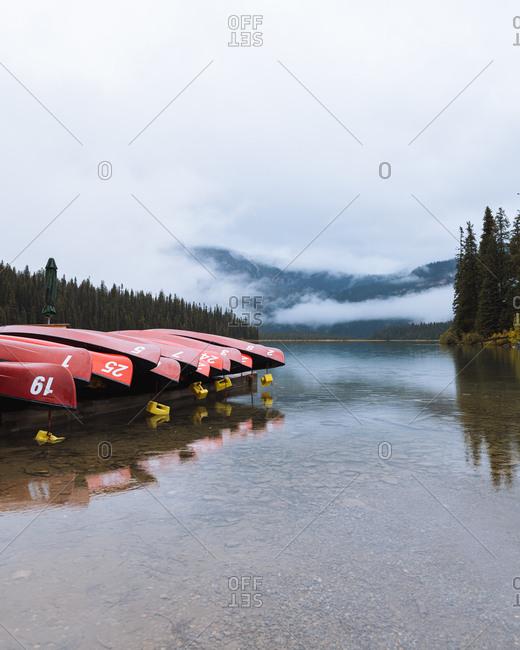 Moored canoes at Emerald Lake Canoe dock, Canadian Rockies, Alberta, Canada