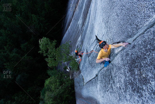 A climber traditional climbing  on granite, Tantalus Wall, Squamish