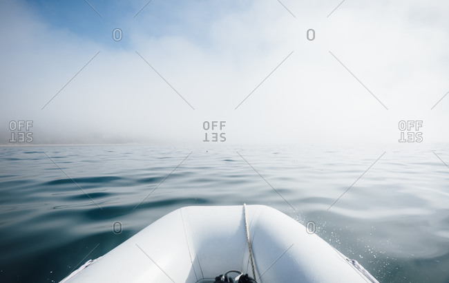 View from inflatable dinghy across Pacific Ocean in misty conditions.