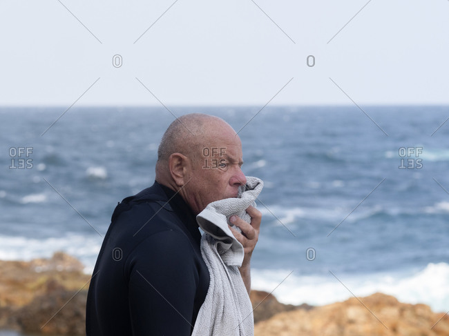 Portrait of senior man going for a swim at a rock pool in Bermagui, Australia.