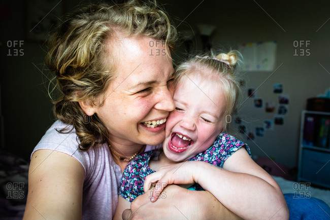 Laughing mom and daughter taking a selfie