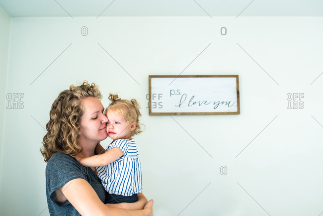 Mother hugging upset baby girl