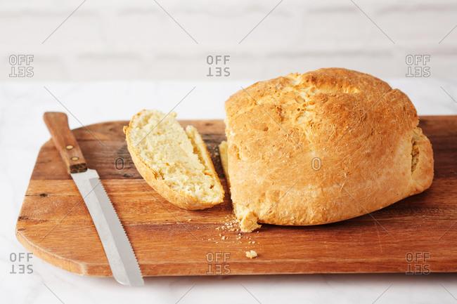 Sliced fresh baked Irish soda bread on cutting board