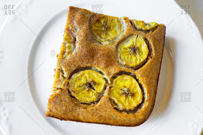 A piece of fresh baked banana bread close up