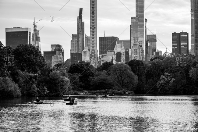 New York City, New York, USA - Oct 25 2019: People in canoes on The Lake in Central Park in Manhattan