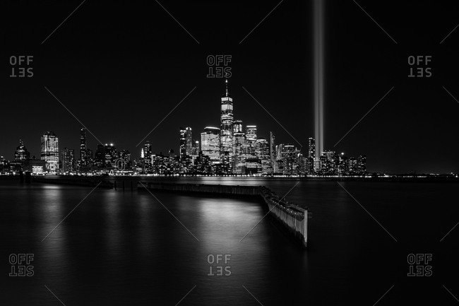 The 9/11 Tribute in Lights temporary monument in lower Manhattan New York City view from Jersey City, New Jersey, USA