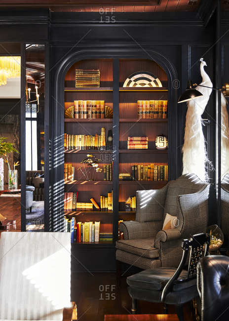 Charleston, South Carolina, USA - September 7, 2018: Interior d�cor with books on an illuminated bookshelf