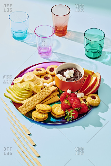 Hot Cocoa Fondue with Various Fruits and Crackers