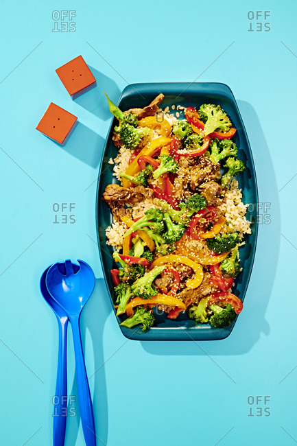 Plated Vegetable Beef Broccoli on Blue Background