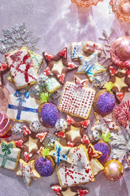 Colorful Christmas Cookies on a Glittery Background