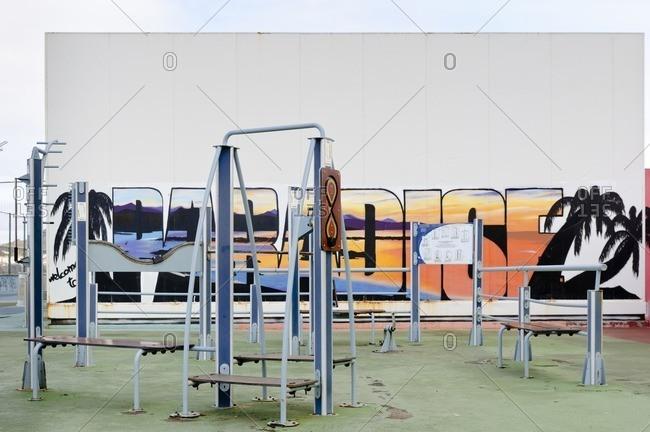 November 20, 2010: Open-air gym with graffiti, Paseo de la Canteras, Las Palmas de Gran Canaria, Gran Canaria, Canary Islands, Spain