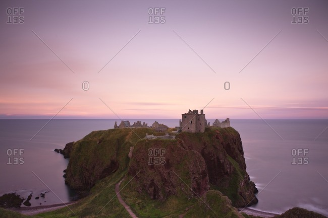 Dunnottar Castle at sunset at Stonehaven, Scotland, Great Britain