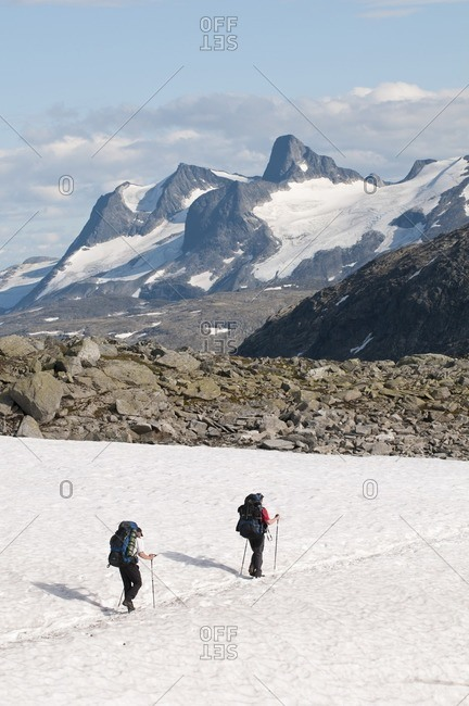 Hikers on a snow field, Jotunheimen National Park, Norway