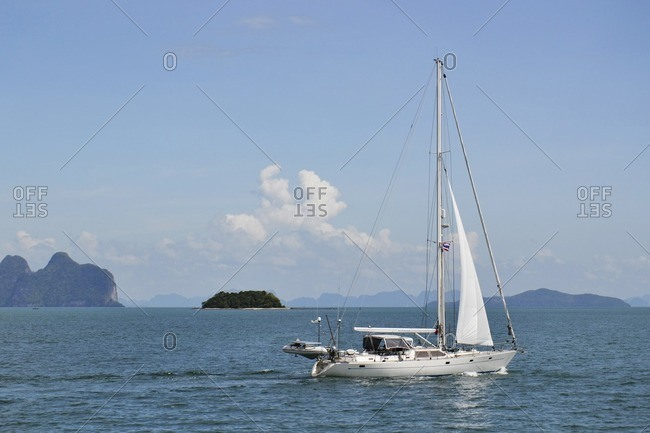 November 29, 2011: Sailing boat in front of islands in the bay of Pang Nga, southern Thailand, Southeast Asia