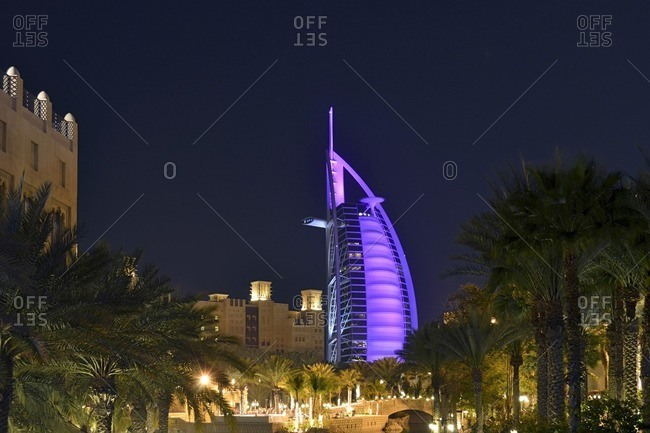 February 15, 2012: Burj al Arab, illuminated, Souk Madinat, Jumeirah, Emirate of Dubai, United Arab Emirates, Arabian Peninsula, Middle East