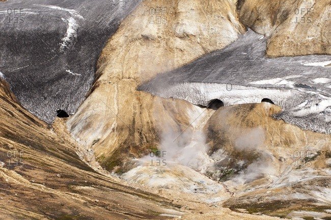 Snow fields and solfatars on the way from Skogar to Landmannalaugar, Iceland, Europe