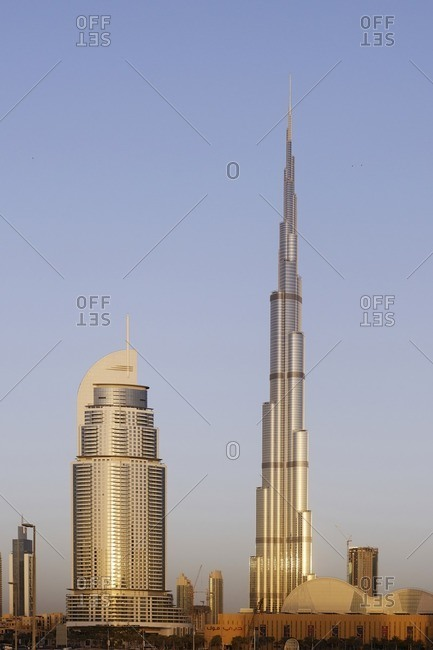 February 15, 2012: The Address and Burj Khalifa in the morning light, Dubai, United Arab Emirates, Asia
